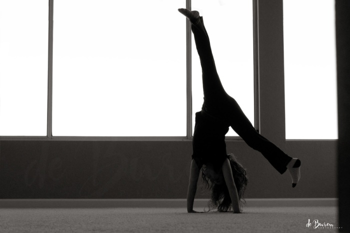 girl cartwheeling in an empty room